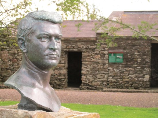 Birthplace of Michael Collins: Bust of Michael Collins and house.
