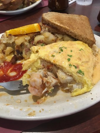 Pembroke, MA: OMG!  One of the best meals I have ever had!  The seafood delight omelette for $13.95. More seaf