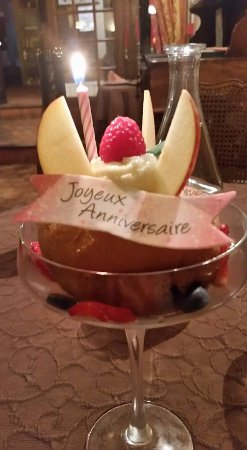 Hotel Restaurant Le Cygne: Desert - Rhum Baba plus birthday wishes. So kind.
