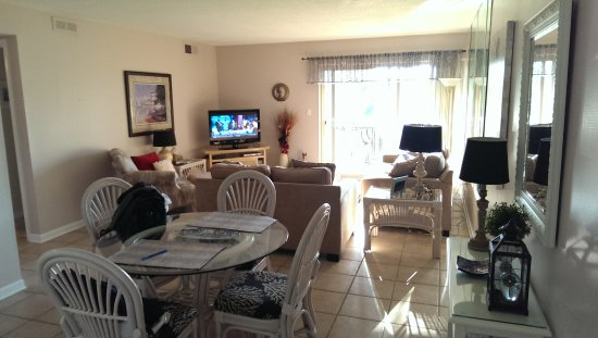 Sea Pines Resort: Living room; patio has table and chairs.