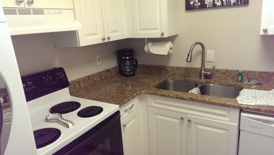 Sea Pines Resort: Kitchen with stacking washer/dryer.