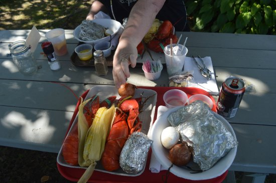 Cabbage Island Clambakes: Steamers in the large foil, baked potato in the other foil.