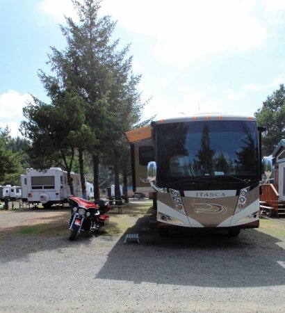 Seaview, WA: Front view of our site with our motorcycle parked beside our coach.