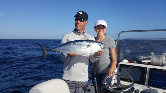 Flatlined Charters: Granddaughter Jenna & Captain George with a Bonita