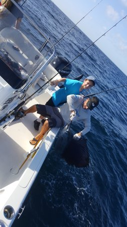 Flatlined Charters: Grandson Michael & Captain George with a Sailfish