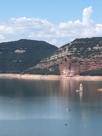 Parador de Vic-Sau: A view of the Parador on the hill from the dam