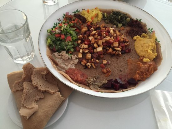 Meals By Genet: Vegetarian combo with Tofu Tibs in the centre.