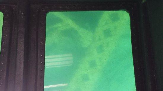 Alpena, MI: View of shipwreck through bottom of boat