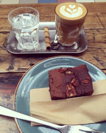 Vegan chocolate brownie and latte.