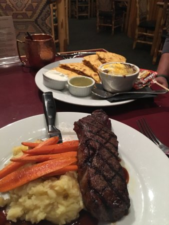 Chet's Bar & Grill: New York strip & the braised pork quesadilla with bison chili. Dinner and service were great. 9/