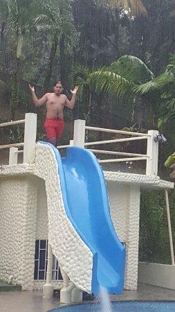 Platanillo, Costa Rica: Older son in the pool slide