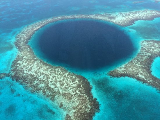 Astrum Helicopters: 55 miles off Belize is the stunning Blue Hole from our Astrum helicopter flown by pilot Gastavo