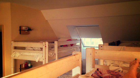 """wombats CITY HOSTEL Vienna """"THE NASCHMARKT"""": View of the 3 bunkbeds from the 6-bed all girl dorm on top floor (much larger away from beds)"""
