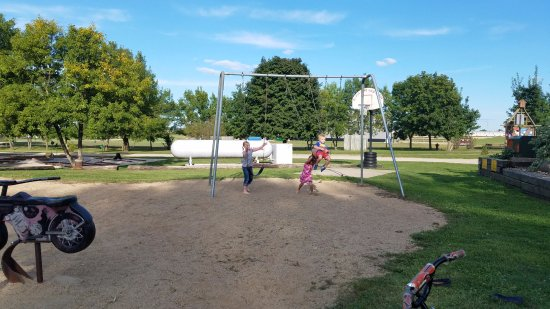Jackson, MN: Little playground with sand, slide and swings.