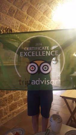 Camelot hotel: Nina proudly displaying her TripAdvisor flag
