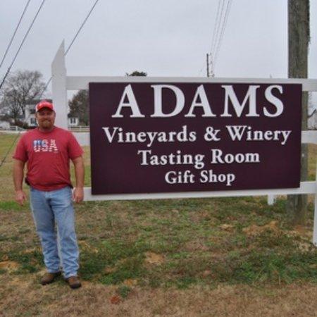 Adams Vineyards: Mr. Quincy Adams proudly posing next to his sign.