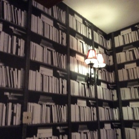 The Hand Hotel: Wall looks like a library but are wallpaper.