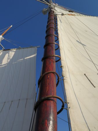 Tall Ship Manitou - Day Tours: Sail attached to main mast with wooden mast hoops