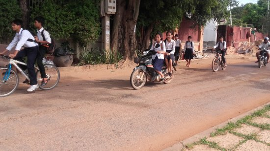 River Village Manor: Kids riding home after school past the guest house