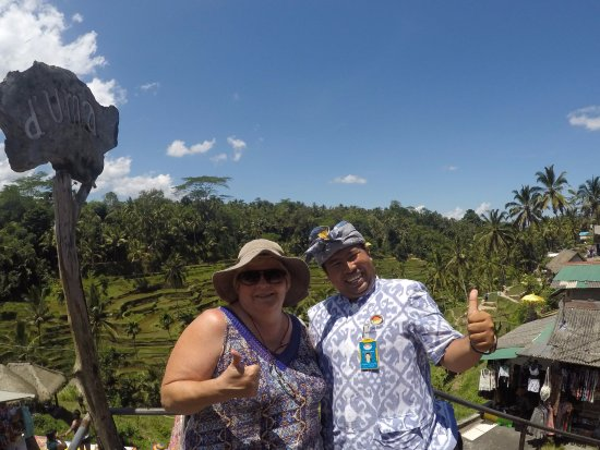 Agus Bali Private Tours: Agus and I at the Ceking Village - rice terraces in the background.