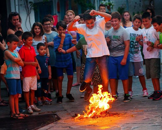 Plaza To Louki: local children take part in the annual feast of St John where they jump through the flames at Lo