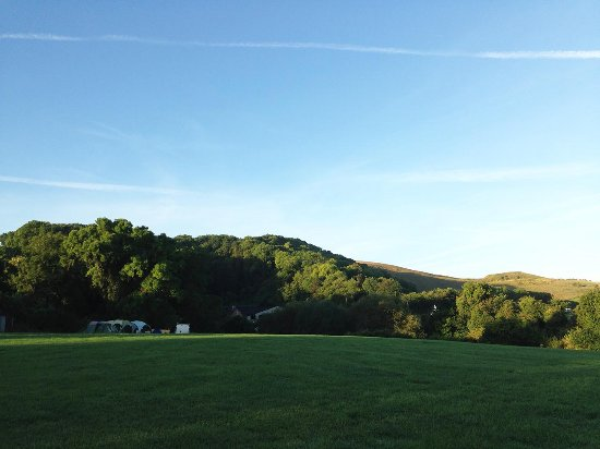Britchcombe Farm Campsite with dragon Hill in background