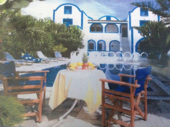 Pension George: This photo is looking towards part of the accommodation from the shaded area by the pool .