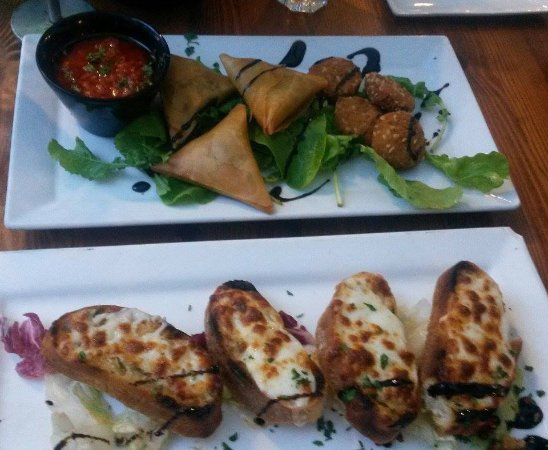 Balzan, Malta: lamb samosas, fried goats cheese, and garlic bread with spicy salsa sauce