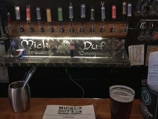 Sandpoint, ID: The Mick Duff craft beer handles behind the bar...