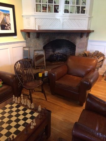 Cooked Goose: Waiting area with chess board and fireplace