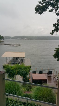 The Garden House Bed & Breakfast: Dock on property. How Tub on deck overlooking Lake of the Ozarks. Creatively Landscaped.