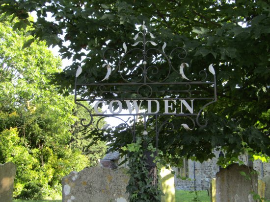 Cowden, UK: Village sign situated in the church grounds