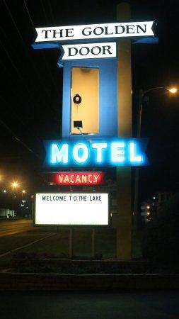 The Golden Door Motel: night view of sign