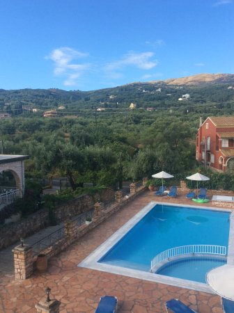 Emily's Apartments : Taken from our balcony. Wonderful mountain views and of the pool