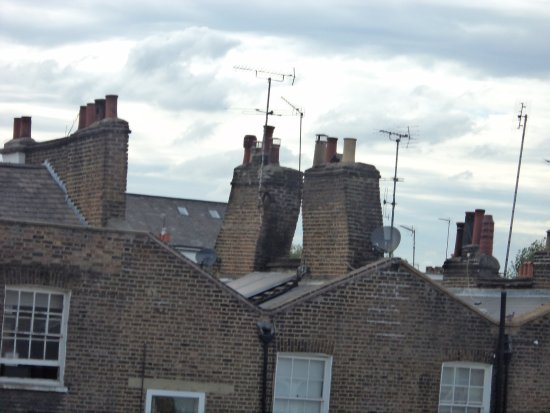 New Linden Hotel: View from bedroom window of unusual inclined chimney stacks.
