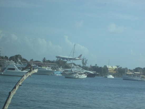 Buccoo Reef: CLOSER VIEW OF THE PLANE LANDING NEAR THE BAY