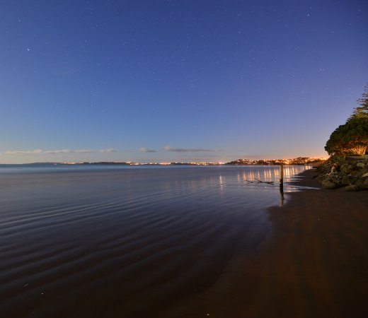 Dusk from about half way up Orewa Beach looking back at the Whangaparaoa Peninsula.