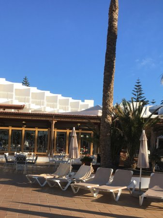 Morning view from the pool to the outdoor breakfasting and eating areas