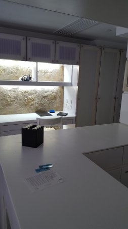 V Wanchai Hotel: Desk area with more storage and pantry. Ironing board and safe box inside closet.