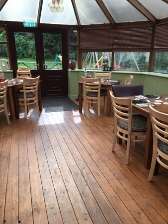 Ossett, UK: Pictures of the refurbished conservatory with a new wooden, waxed floor, new dining chairs and i