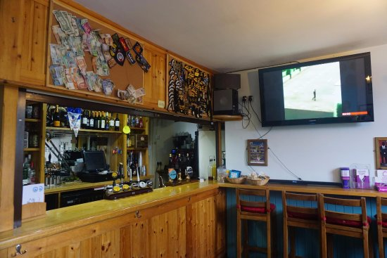 The Ship in Dock Inn: The bar area, with large TV