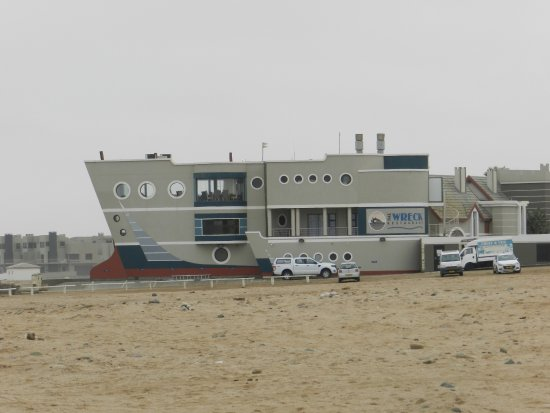 The Wreck Restaurant: The Wreck, photographed from across the beach in morning light.