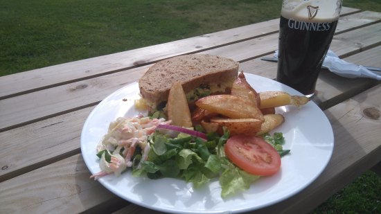 Otley, UK: Cheese and chutney sandwich with salad and chips