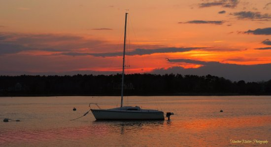 Onset, MA: A sailboat witnesses sunset at Shell Point by Heather Mattos Photography