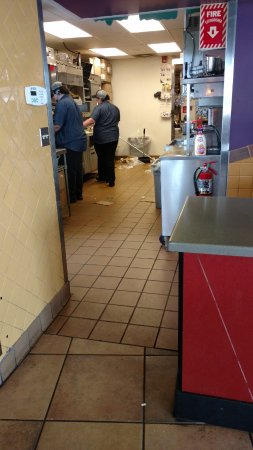 Perry, MI: the view while waiting for my order. trash over flowing.