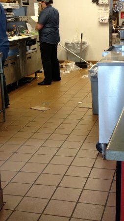 Perry, MI: trash all over food making area floor. right in customers view.