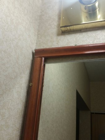 "Comfort Inn: Wood frame 'upgrade' done by who - looks like a 12 year old with no skills! ""There I fixed it."""