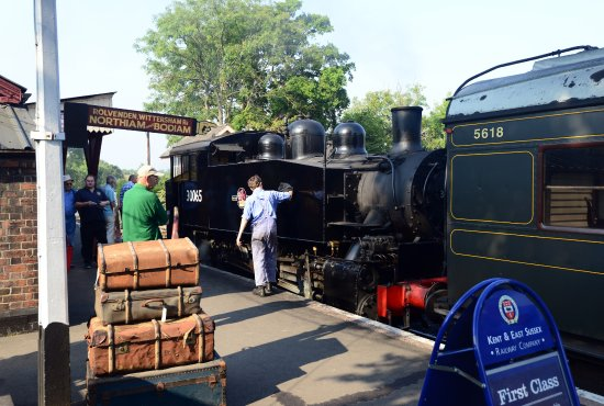 USA 0-6-0 Tank 30065 receives a quick polish from the driver at Tenterden station.