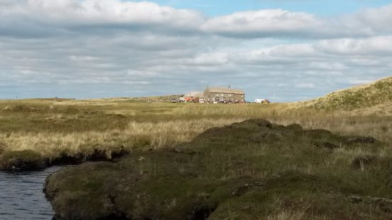 Low Row, UK : View of The Tan Hill Inn from The Pennine Way