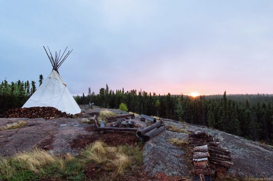 Blachford Lake Lodge: The teepee and fire pit overlooking the grand landscape.